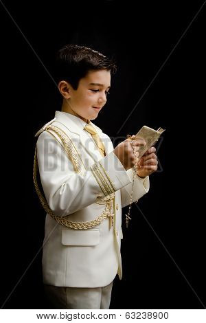 Young Boy With Rosary And Prayer Book