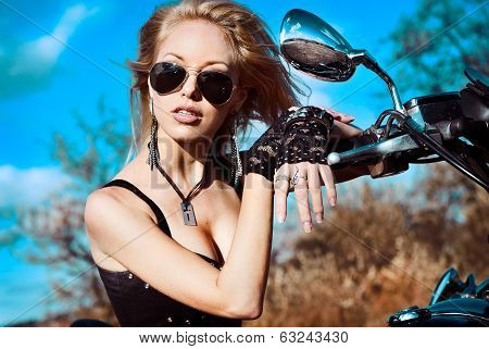 Young beautiful woman and bike