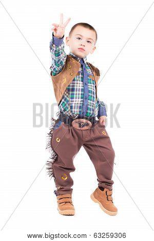 Little Boy Posing In Cowboy Costumes