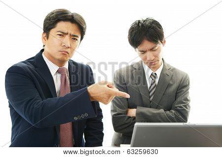 Stressed Asian businessmen