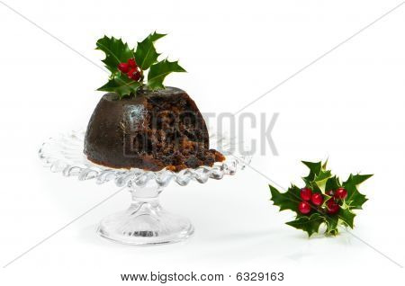Christmas pudding on glass comport with holly and berries decoration poster