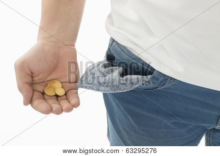 Man in blue jeans while shows his empty pockets