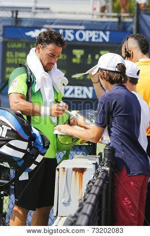 Professional tennis player Fabio Fognini signing autographs after match at US Open 2014