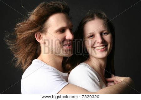 Young Man And Woman Isolated On Black Background