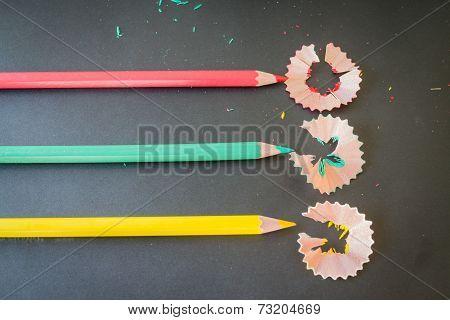 Multi Color Pencils Shavings On Dark Background