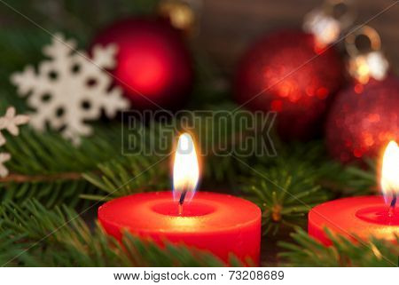 Closeup Of A Candle With Christmas Decoration