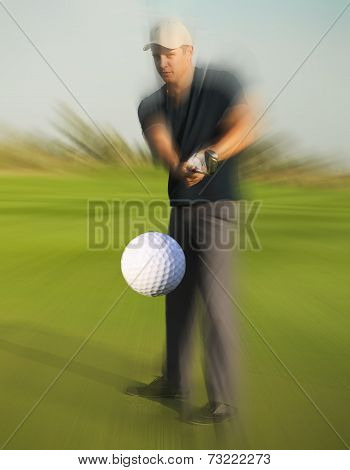 Golf Ball Just Coming Off A Golfer In Swing