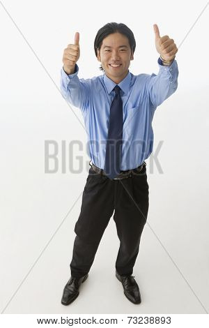 Asian businessman giving two thumbs up