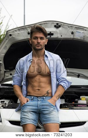 Muscular Macho Man With His Car