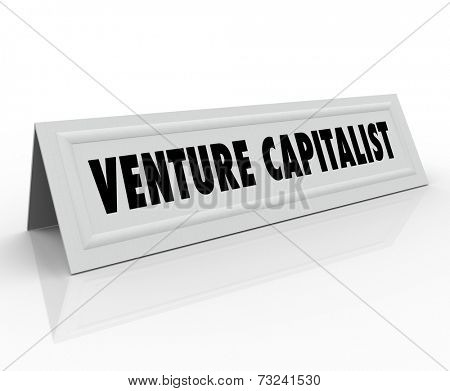 Venture Capitalist words on a name tent card for a startup funder, investor or finance person