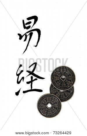 I ching coins with chinese calligraphy script, translation reads as I ching.