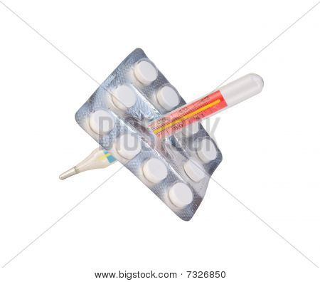 Pack Of Tablets And Thermometer
