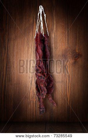 jerky beefi on a wooden background
