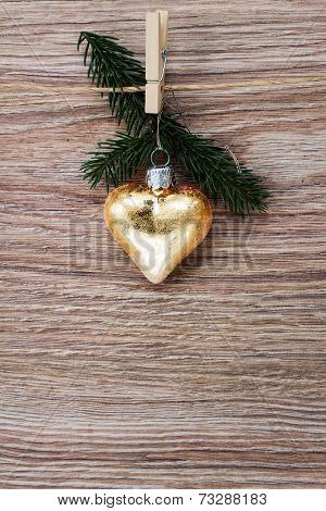 christmas golden heart with green  twig