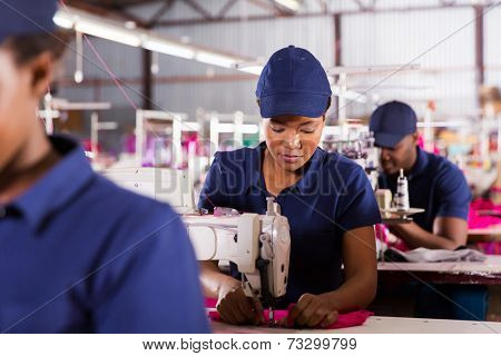 african textile factory machinist working in production line