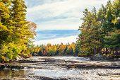 Mill falls in fall (Kejimkujik National Park Nova Scotia Canada) poster
