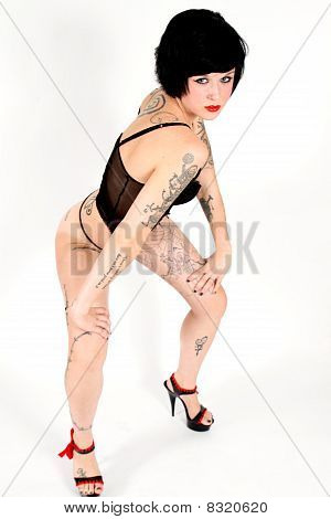 Young Model With Tattoos In Lingerie