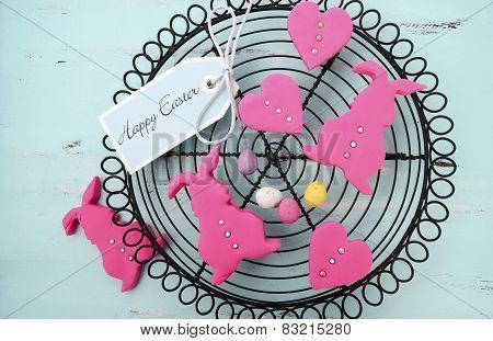 Happy Easter Pink Confectionary Sugar Fondant Cookie Bunnies On Vintage Baking Rack On Pale Aqua Blu