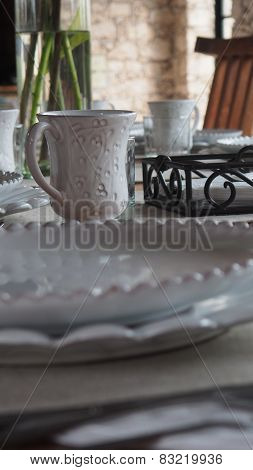 Rustic style ranch chinaware breakfast table setup