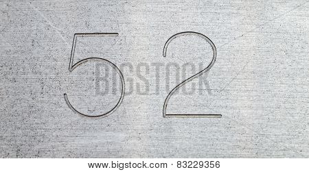 Number fifty two on a metal plate