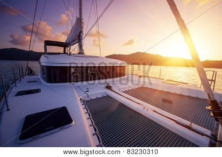 Beautiful view to catamaran in Seychelles bay at sunset