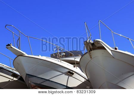 yacht in the winter on the pier on the background of blue sky
