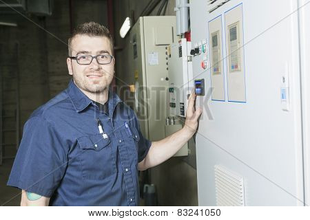 repairman engineer control panel valve equipment in a boiler hou