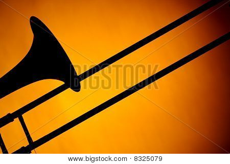 Trombone Silhouette Isolated On Gold
