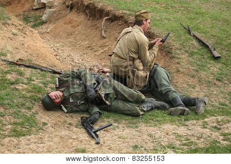 ORECHOV, CZECH REPUBLIC - APRIL 27, 2013: Re-enactors dressed as Soviet and German Nazi soldiers stage an attack during the re-enactment of the Battle at Orechov (1945) near Brno, Czech Republic.