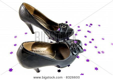 black shoes with violet stars on white background