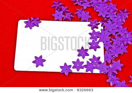 white card and violet stars on red background