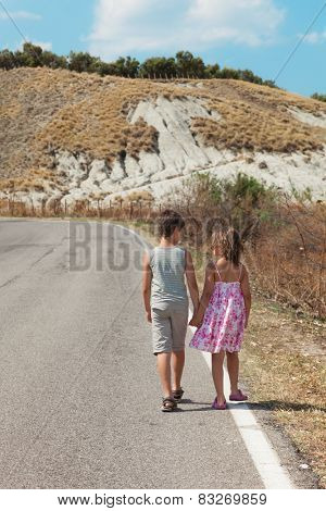 portrait of two children on the road, rea view