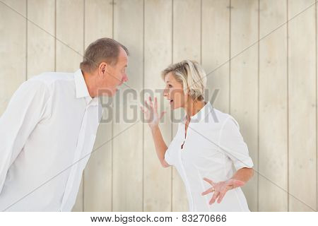 Angry older couple arguing with each other against wooden planks poster