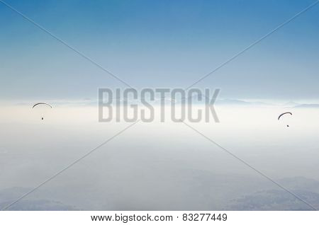 Paragliding high against clouds