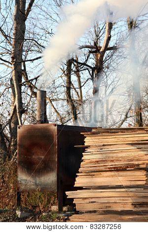 BBQ smoker with wood pile