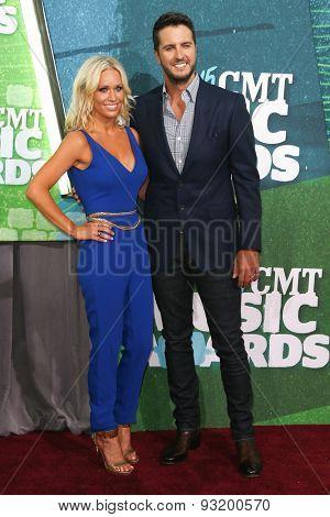 NASHVILLE, TN-JUN 10: Singer Luke Bryan (R) and wife Caroline Boyer attend the 2015 CMT Music Awards at the Bridgestone Arena on June 10, 2015 in Nashville, Tennessee.