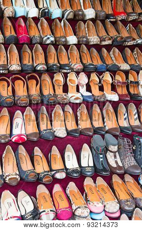 ISTANBUL - MAY 3: Faked shoes on sale on the narrow street around Grand Bazaar on Mal 3, 2015 in Istanbul,Turkey. Area around Grand Bazaar is well known seeling place for replica shoes, bags and jeans