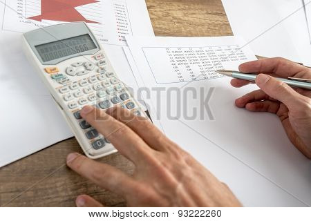 Closeup Of Male Financial Adviser Calculating Numbers