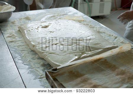 Baker Prepping A Flat Of Ciabatta Dough