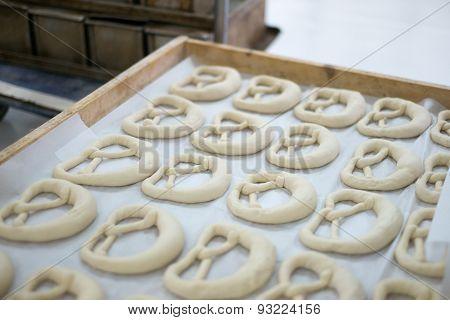 Fresh Pretzel Or Brezel Dough On Baker's Tray