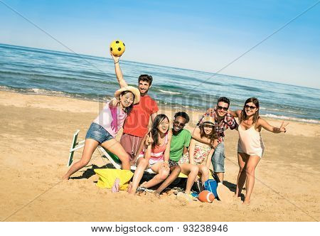Group Of Multiracial Happy Friends Having Fun With Beach Sport Games - International Summer Concept
