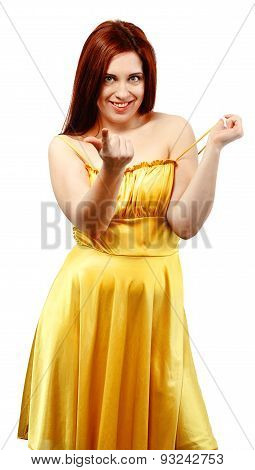 Portrait Of A Sexy Woman In Yellow Dress Making A Beckoning Gesture