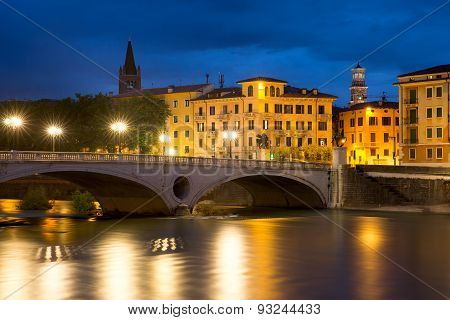 Bridge Ponte Risorgimento and the River Adige at night illumination, Verona, Italy poster