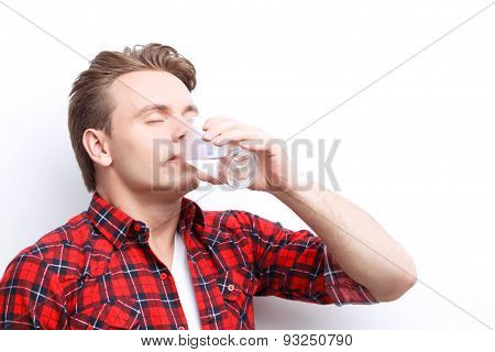 Pleasant guy drinking water