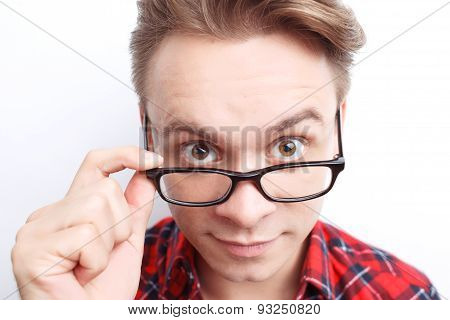 Surprised guy holding glasses