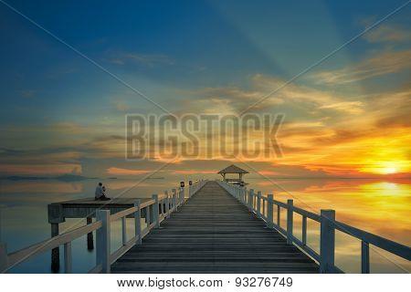 Sunset And Wooded Bridge