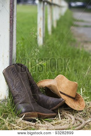 Western shoes and cowboy hat on American ranch background poster