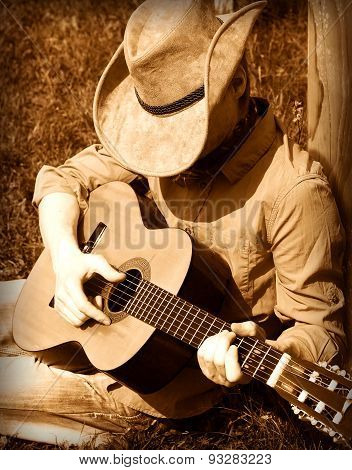 Cowboy Plays Guitar