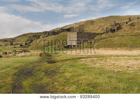 Concrete ruins remains of stone quarry. Clee Hill Shropshire England United Kingdom. poster