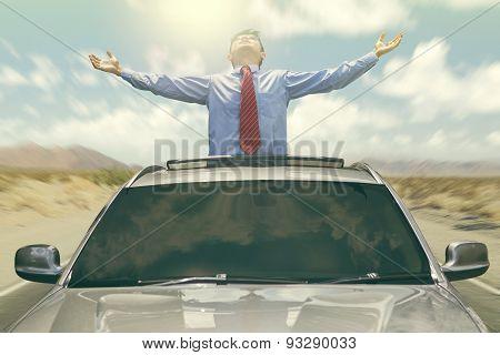 Businessman Enjoy Freedom In The Car